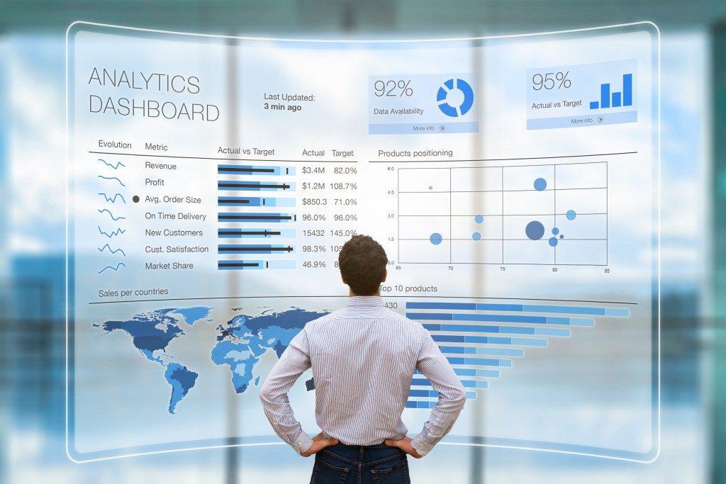 man analyzing a visual digital dashboard