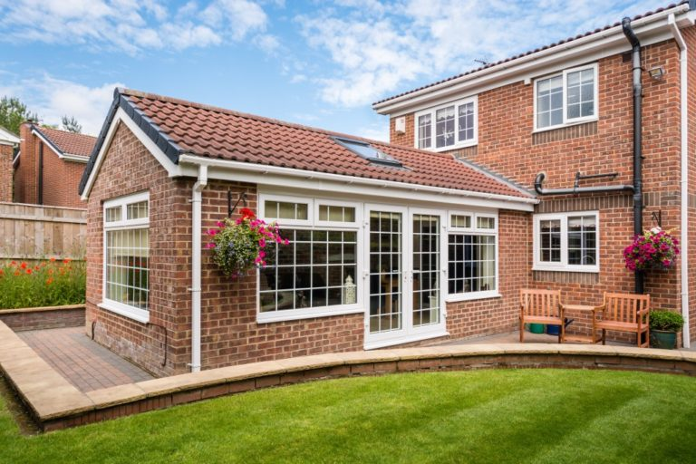 Modern Sunroom or conservatory extending into the garden
