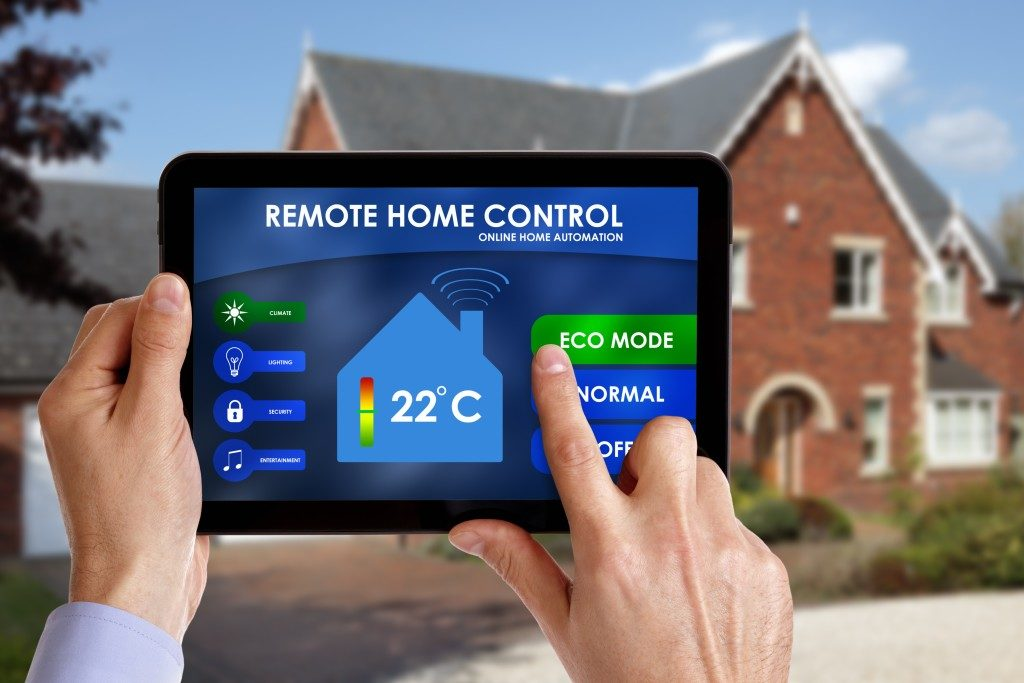 Holding a smart energy controller or remote home control online home automation system on a digital tablet