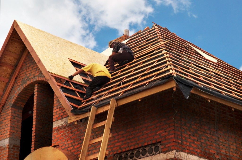 people building a roof