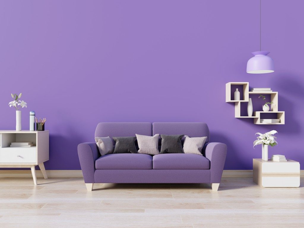 Purple couch with purple wall