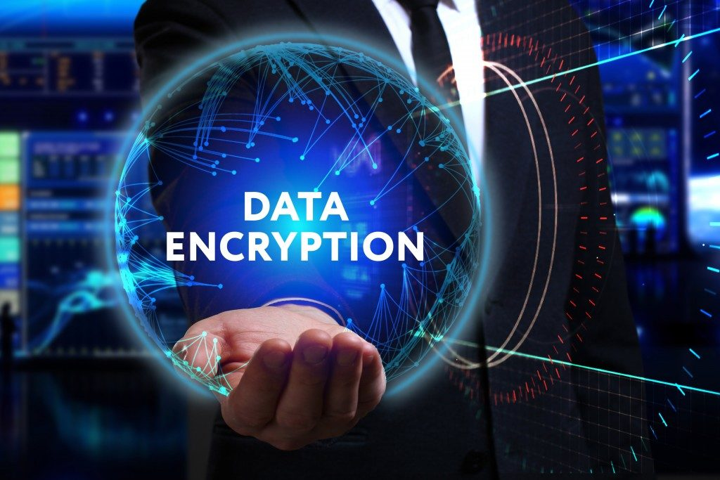 businessman holding digitalized data encryption