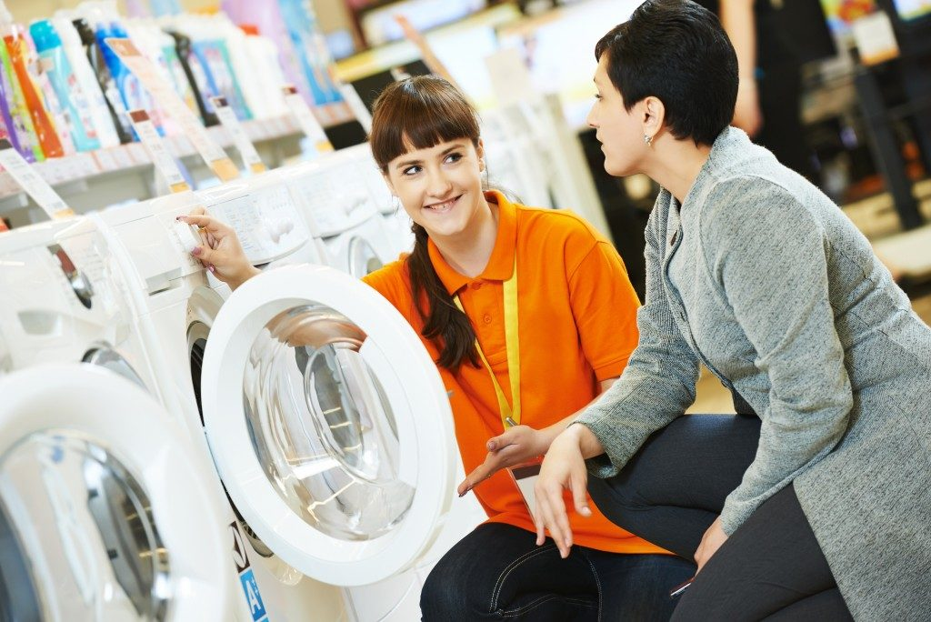 saleslady showing washing machines