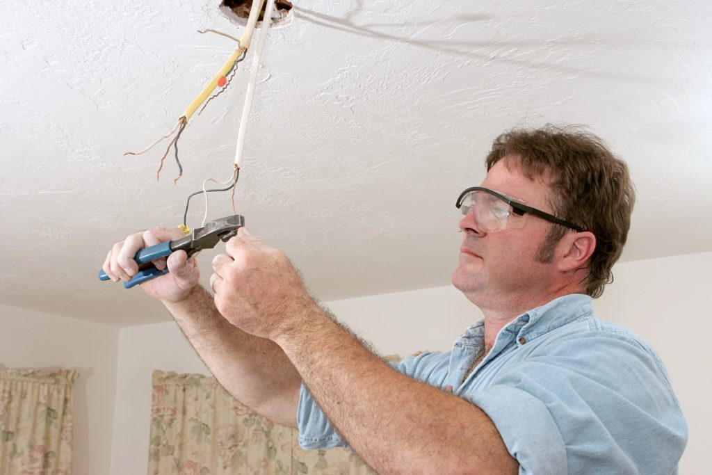 Man fixing wires