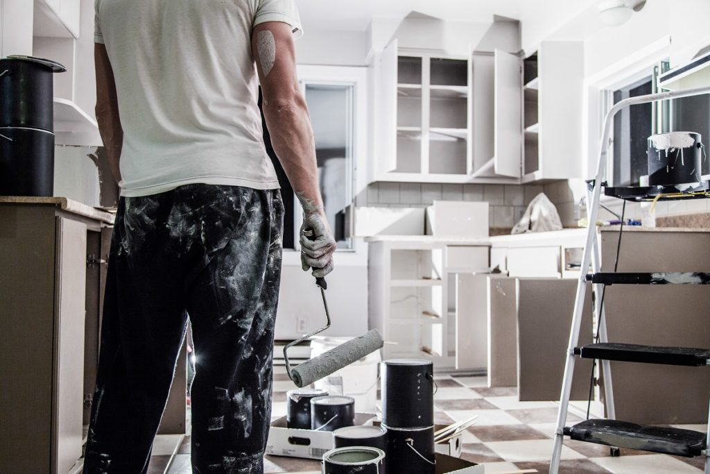 man painting the kitchen
