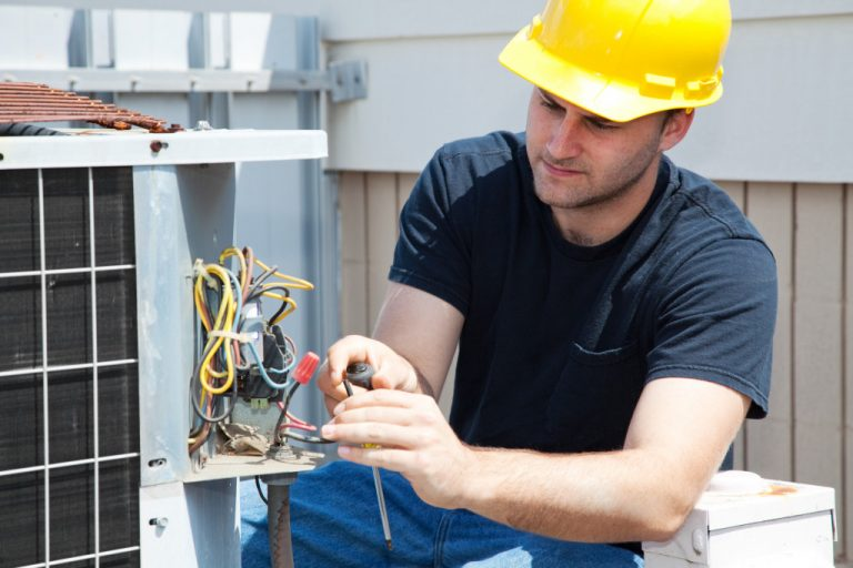 man fixing aircon unit