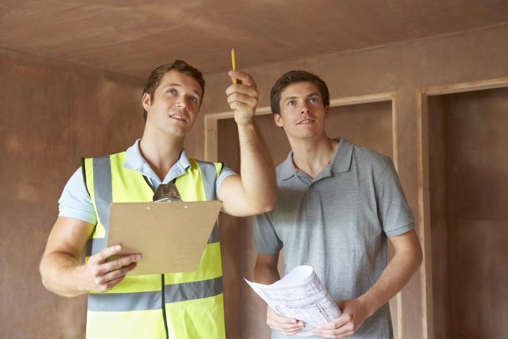 men inspecting a home